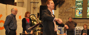 Reverend Andrew Hargreaves (Trustee) leads the congregation at St James' church